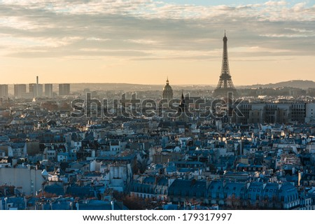 Paris skyline sunset view with the Eiffel tower from the roof of notre-dame de Paris  - stock photo