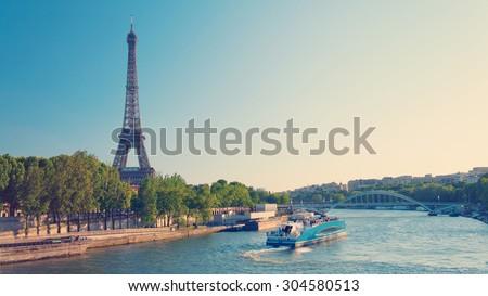 Paris skyline with Eiffel Tower and Seine River - stock photo