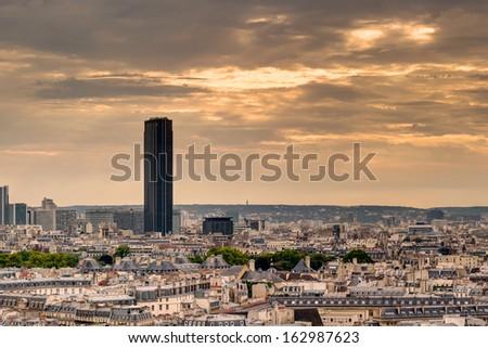 Paris skyline with Maine-Montparnasse Tower at sunset - stock photo
