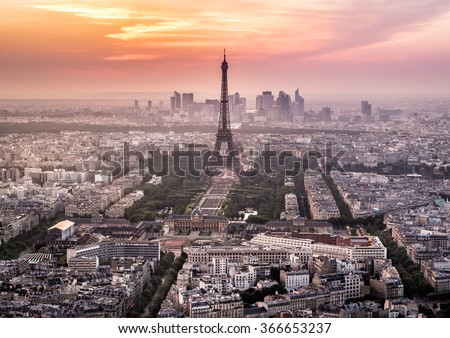 Paris skyline with Tour Eiffel during sunset with pink and orange sky - stock photo