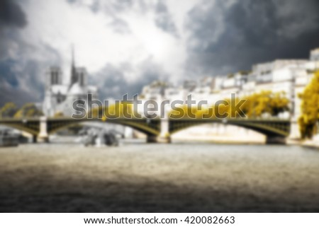 Paris, the Seine and Notre Dame background blurred effect - stock photo