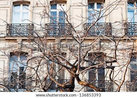 Paris urban building in early spring afternoon - stock photo