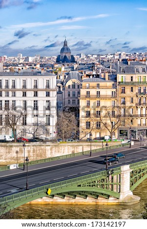 Paris view with a green bridge over the Seine in the foreground and the heart of the old city, the historic Marais neighborhood in the background. Crisp image with sharp detail. Copy space. - stock photo