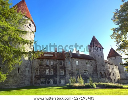 Park and fortification wall with turrets in old town. Tallinn. Estonia - stock photo