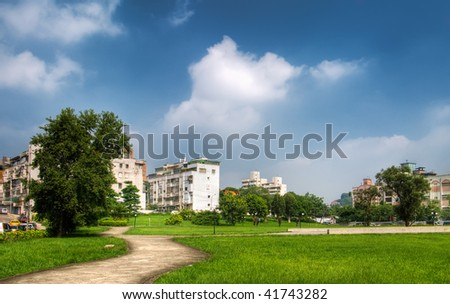 Park and house under the beautiful sky in the outdoor. - stock photo