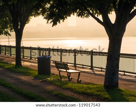 Park bench on the Charles River, Boston, MA - stock photo