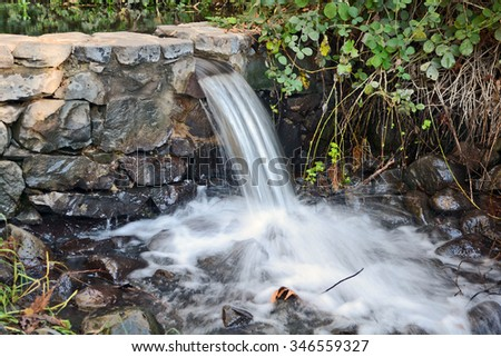 park creek with a small waterfall in the vicinity of Katzrin in the Golan Heights - stock photo