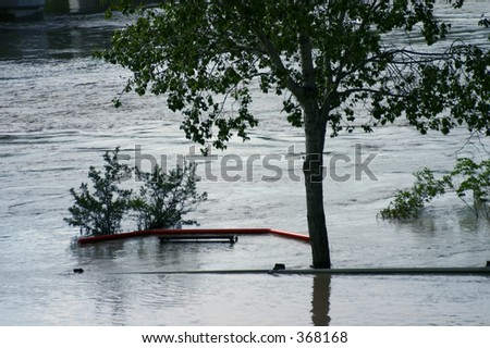 Park flooded - Medicine Hat, Alberta. A road was here, as evident from the bench. - stock photo