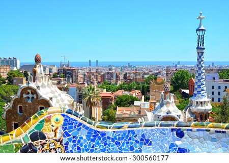 Park Guell by architect Antoni Gaudi in Barcelona, Spain. Focus on the panorama of the city of Barcelona - stock photo