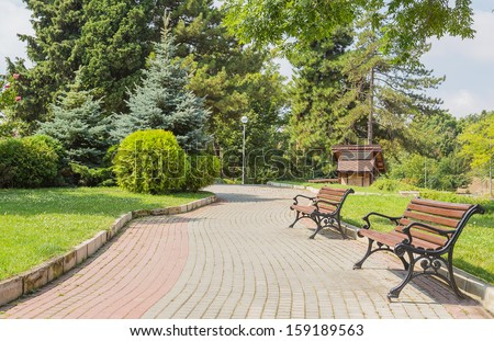 park, path, bench day background - stock photo