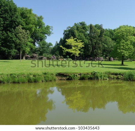 park with a small pond in spring time in the netherlands - stock photo