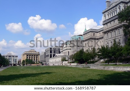 Park with grass surrounded by old buildings in Montreal, Canada - stock photo