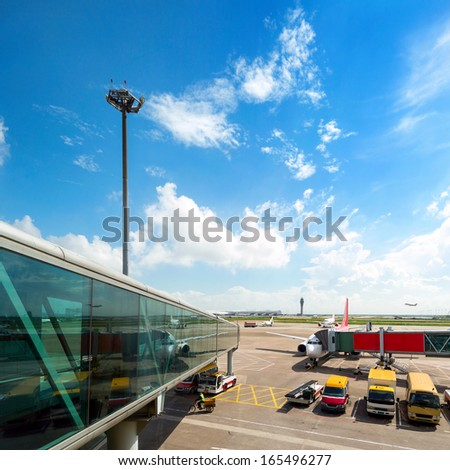 Parked aircraft on shanghai airport through the gate window. - stock photo