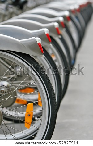 parked bicycles in row, paris - stock photo