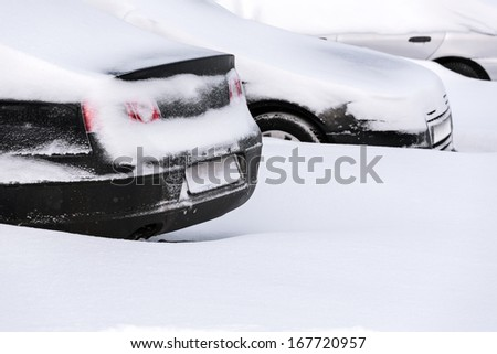 Parked cars covered in fresh snow - stock photo