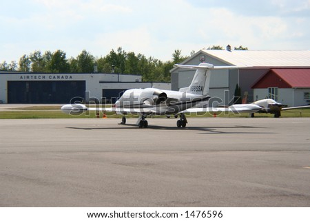 Parked lear jet - stock photo