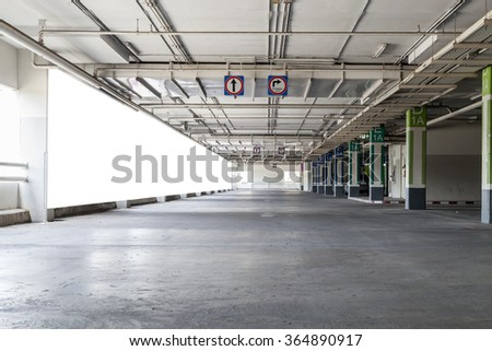 Parking garage interior, industrial building,Empty underground parking background with blank billboard - stock photo