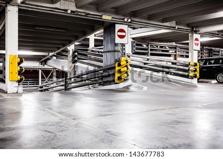 Parking garage lot, urban scene at night in city and cars on parking lot. Dark and grunge construction interior. - stock photo
