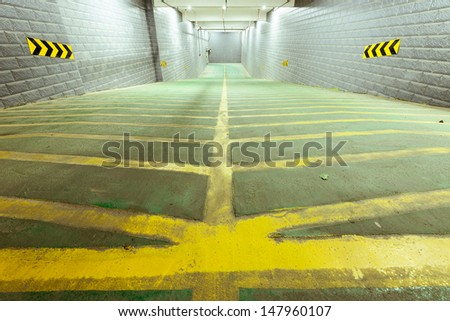 Parking garage underground, industrial interior. - stock photo