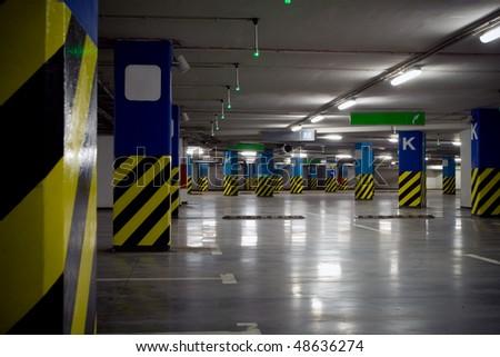 Parking garage, underground interior - stock photo