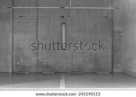 Parking garage underground interior, neon lights in dark - stock photo