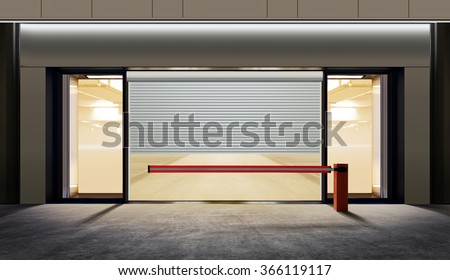 parking in basements with barrier at night - stock photo