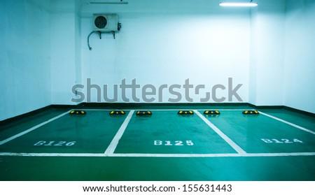 Parking lot in an underground garage - stock photo