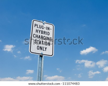 Parking lot sign for electric or hybrid car - stock photo