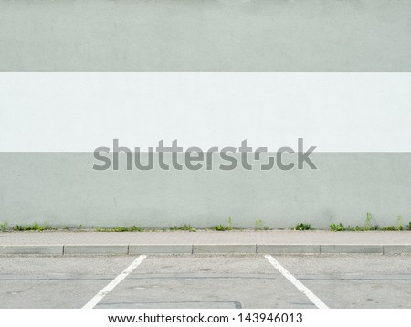 Parking lot wall and sidewalk - stock photo