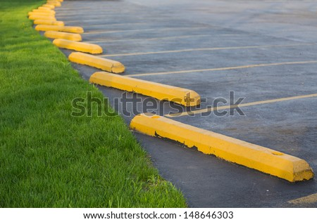 parking lot with grass - stock photo
