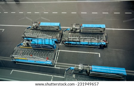 Parking of luggage carrying vehicles in modern airport - stock photo
