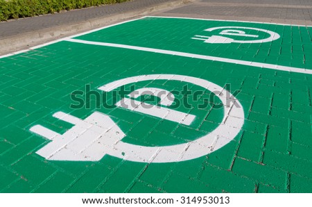 parking place with charging symbol for electric cars - stock photo