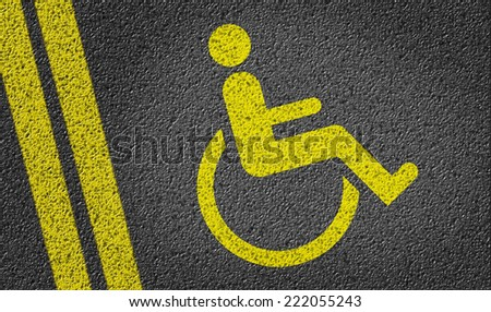 Parking space reserved for Handicapped shoppers in a retail parking lot - stock photo
