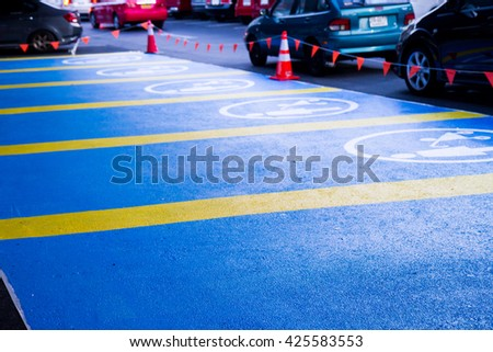 parking space reserved for The Pregnant Woman and  handicapped shoppers in a retail parking lot. - stock photo