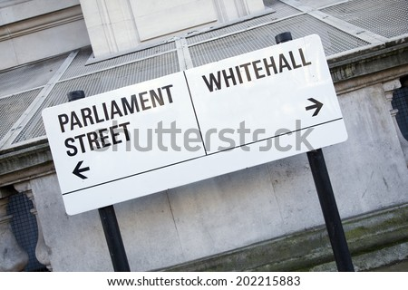 Parliament and Whitehall Street Sign in Westminster London, England, UK - stock photo