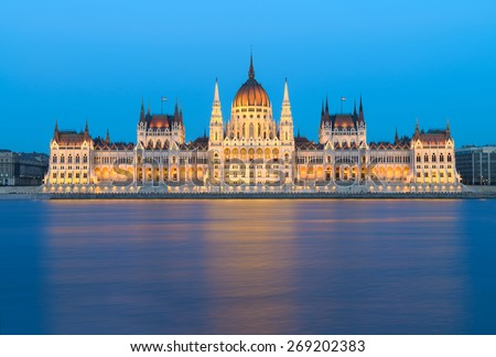 Parliament building at night in Budapest, Hungary, text space on the water - stock photo