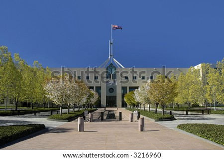 Parliament House in Australian capital city Canberra, waving flag - stock photo