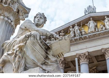 parliament in vienna, austria. seat of government. fountain - stock photo
