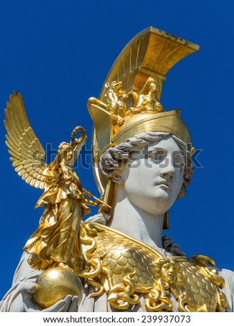 parliament in vienna, austria. with the statue of pallas athena of the greek goddess of wisdom. - stock photo