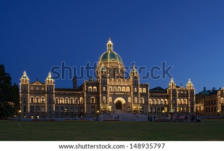 parliament of BC in Victoria  lit up at dusk; oblique view - stock photo