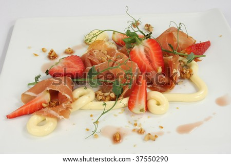 Parma Ham and strawberry salad - stock photo