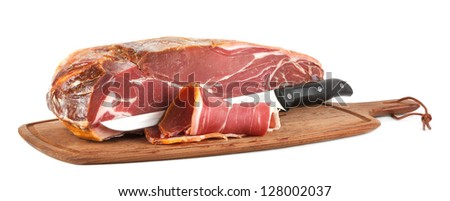 parma ham with a knife (isolated on white) - stock photo