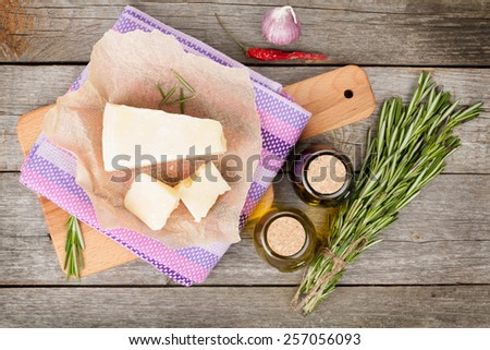 Parmesan cheese, herbs and spices on wooden table background - stock photo