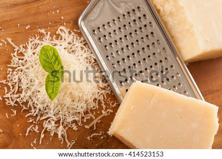 Parmesan cheese on wood background - stock photo