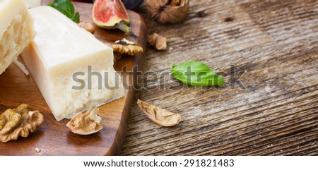 parmesan cheese on wooden table with copy space - stock photo