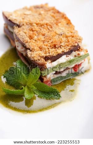Parmigiana vegetable, cream of basil and fresh basil leaves - stock photo