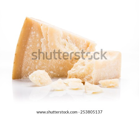 Parmigiano reggiano on white background, close-up. - stock photo