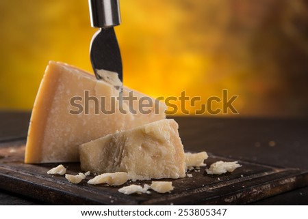 Parmigiano reggiano on wooden background, close-up. - stock photo