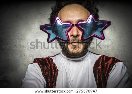 Parody, stupid man with glasses graceful gestures and ridiculous party - stock photo