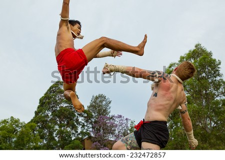 PARRAMATTA,AUSTRALIA - NOVEMBER 22,2014: Two fighters demonstrate the martial art of Muay Thai at a festival celebrating Thai culture and tradition. - stock photo